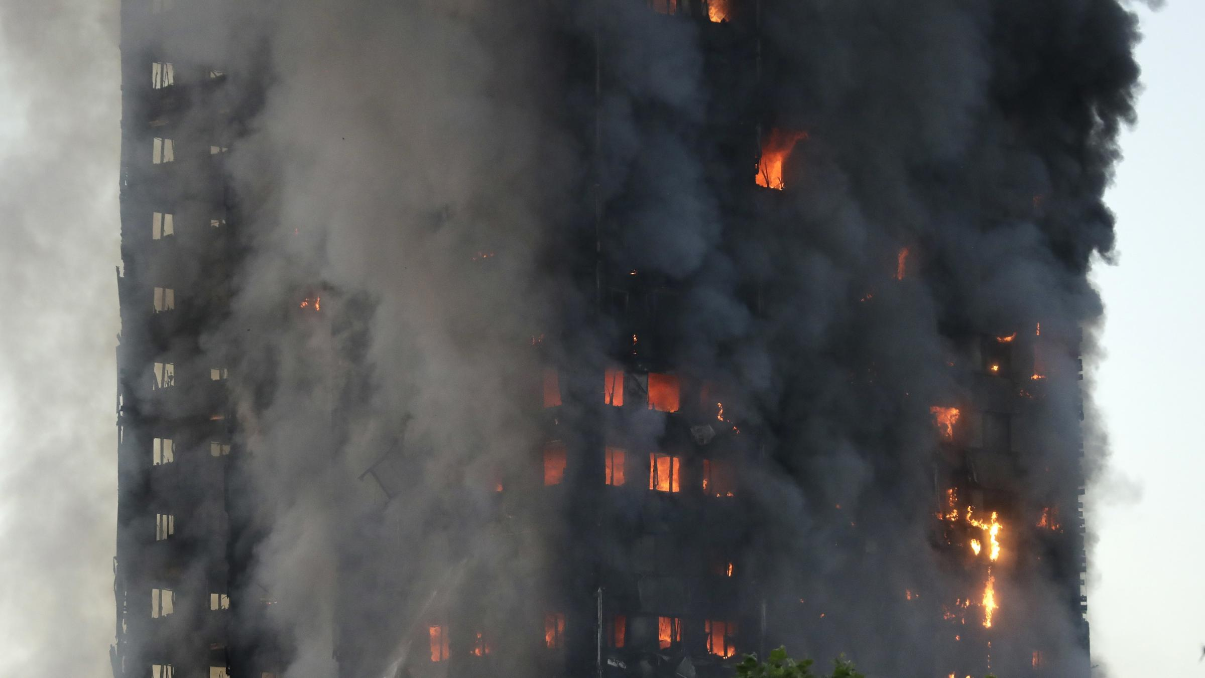 Death toll from London tower block fire rises to 12